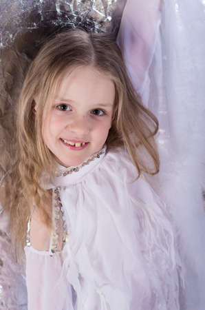 dance preteen: young girl in long white dress with long hair in  the dance pose Stock Photo