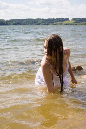 wet dress: teen mernaid  Girl in white wet dress Outdoors in the lake