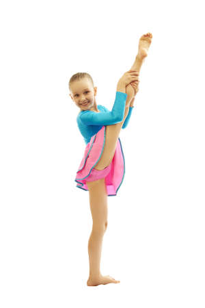 beautiful preteen girl: young smiling preteen girl doing gymnastics stretching  exercises on white background isolated