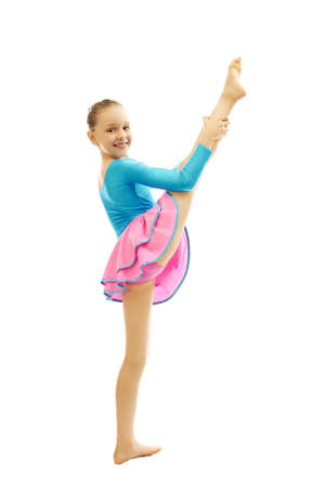 dance preteen: young smiling preteen girl doing gymnastics stretching  exercises on white background isolated