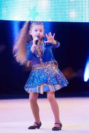 dance preteen: MINSK, BELARUS DECEMBER 05: Sofia Bogdanova sing a song during Baby Cup - BSB Bank childrens competitions in gymnastics , 05 December 2015 in Minsk, Belarus. Editorial