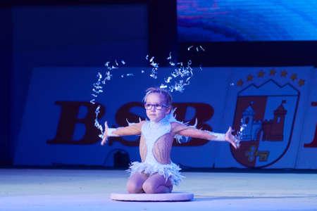 dance preteen: MINSK, BELARUS DECEMBER 05: Miroslava Vabischevich from  SK Mowgli participate with Angel of Peace  in Baby Cup - BSB Bank childrens competitions in gymnastics , 05 December 2015 in Minsk, Belarus.