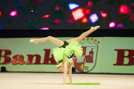 turmoil: MINSK, BELARUS DECEMBER 05: Ulas Kristina from  SK Mowgli participate with Merry turmoil  in Baby Cup - BSB Bank childrens competitions in gymnastics , 05 December 2015 in Minsk, Belarus. Editorial