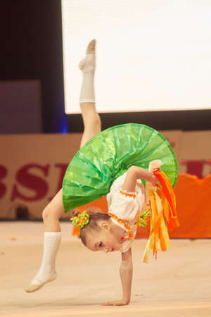 dance preteen: MINSK, BELARUS DECEMBER 05: Myat Milana from  Baranovichi participate with Orange song  in Baby Cup - BSB Bank childrens competitions in gymnastics , 05 December 2015 in Minsk, Belarus.