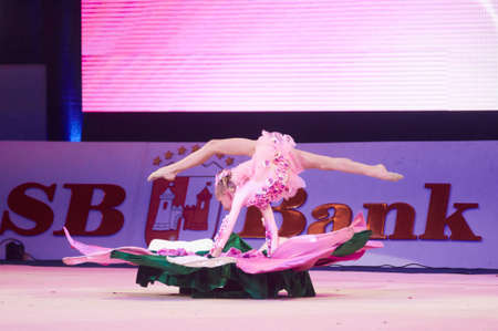 dance preteen: MINSK, BELARUS DECEMBER 05: Bolzan Vlada from trade union sports School participate with Thumbelina  in Baby Cup - BSB Bank childrens competitions in gymnastics , 05 December 2015 in Minsk, Belarus.