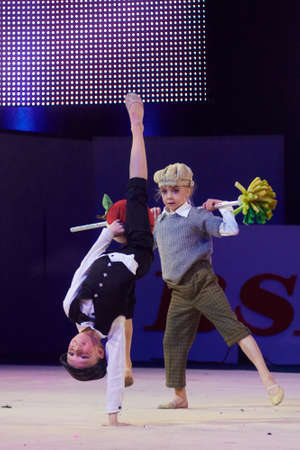 grand kids: MINSK, BELARUS DECEMBER 05: Saleyko, Falko from  Baranovichi participate with Tom Sawyer  in Baby Cup - BSB Bank childrens competitions in gymnastics , 05 December 2015 in Minsk, Belarus.