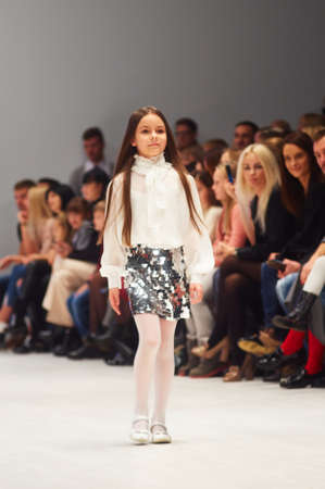 MINSK-OCTOBER 29: An unidentified girl wears NAVY collection at the international exhibition of the fashion industry, Kids fashion day during Belarus Fashion Week on October 29, 2017 in Minsk, Belarus.