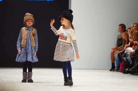 famous industries: MINSK-OCTOBER 29: An unidentified girl wears Leya.me collection at the international exhibition of the fashion industry, Kids fashion day during Belarus Fashion Week on October 29, 2017 in Minsk, Belarus.