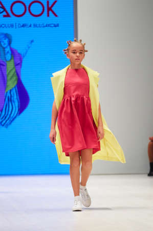 MINSK-OCTOBER 29: An unidentified girl wears Totallook collection at the international exhibition of the fashion industry, Kids fashion day during Belarus Fashion Week on October 29, 2017 in Minsk, Belarus. Editorial