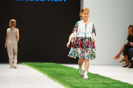 MINSK-OCTOBER 29: An unidentified girl wears CRYSTAL NYMPH collection at the international exhibition of the fashion industry, Kids fashion day during Belarus Fashion Week on October 29, 2017 in Minsk, Belarus.