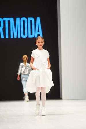 MINSK-OCTOBER 29: An unidentified girl wears ARTMODA collection at the international exhibition of the fashion industry, Kids fashion day during Belarus Fashion Week on October 29, 2017 in Minsk, Belarus. Editorial