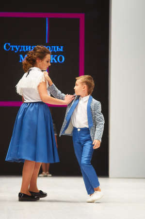 MINSK-OCTOBER 29: An unidentified girl wears MUGAKO collection at the international exhibition of the fashion industry, Kids fashion day during Belarus Fashion Week on October 29, 2017 in Minsk, Belarus.