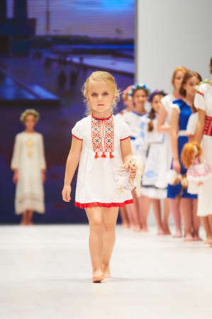 MINSK-OCTOBER 29: An unidentified girl wears Lubna collection at the international exhibition of the fashion industry, Kids fashion day during Belarus Fashion Week on October 29, 2017 in Minsk, Belarus.