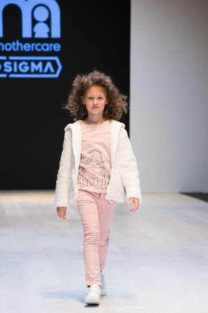 girl wears children dress collection at the international exhibition of the fashion, Kid's fashion day during Belarus Fashion Week Zdjęcie Seryjne - 123782634