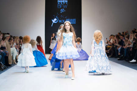MINSK-NOVEMBER 7: An unidentified girl wears dress collection at the international exhibition of the fashion, Kids fashion day during Belarus Fashion Week on November 7, 2018 in Minsk, Belarus.