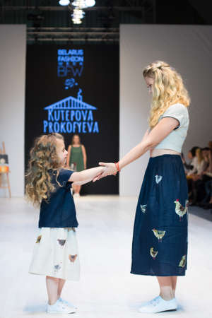 girl wears children dress collection at the international exhibition of the fashion, Kid's fashion day during Belarus Fashion Week Zdjęcie Seryjne - 123782649