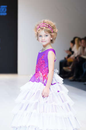 girl wears children dress collection at the international exhibition of the fashion, Kid's fashion day during Belarus Fashion Week