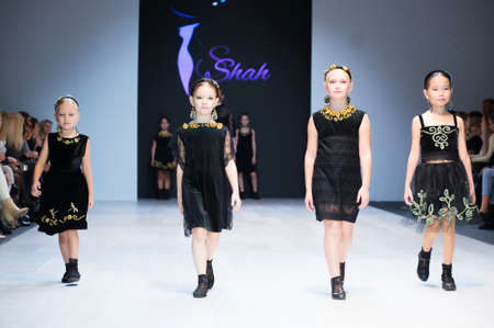 girl wears children dress collection at the international exhibition of the fashion, Kid's fashion day during Belarus Fashion Week Zdjęcie Seryjne - 123782662