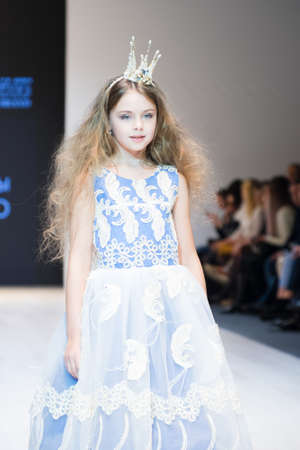 girl wears children dress collection at the international exhibition of the fashion, Kid's fashion day during Belarus Fashion Week Zdjęcie Seryjne - 123782663