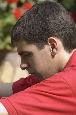grieving: Thoughtful teenager Stock Photo