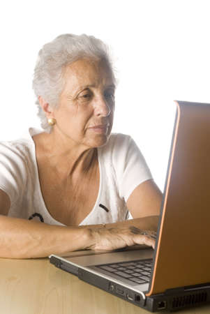 senior woman doing research on-line. photo