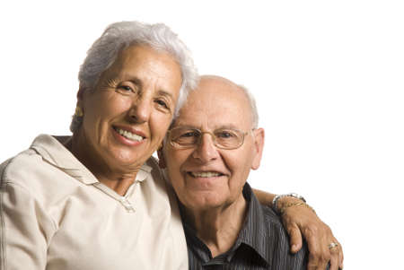 A loving, handsome senior couple on a white background photo