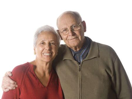 Loving, handsome senior couple on a white background Stock Photo