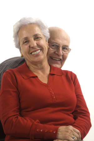 Loving, handsome senior couple on a white background Stock Photo - 2533848