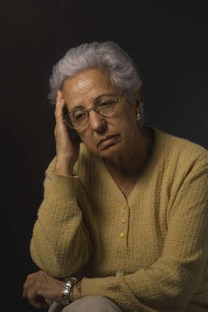 Senior woman looking depressed on black background Stock Photo - 2533852