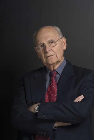 distinguished: Senior distinguished business man over dark background