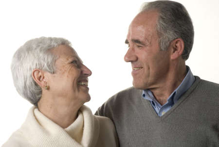 Loving senior couple looking at each other over white background Stock Photo - 2626838