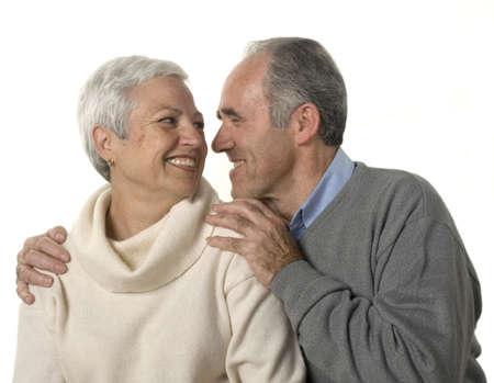 Loving senior couple looking at each other over white background Stock Photo - 2626833