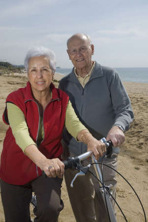 Active senior couple biking by the sea Stock Photo - 2954398