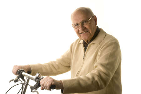 Active senior man riding his bike isolated on white Stock Photo - 2954391