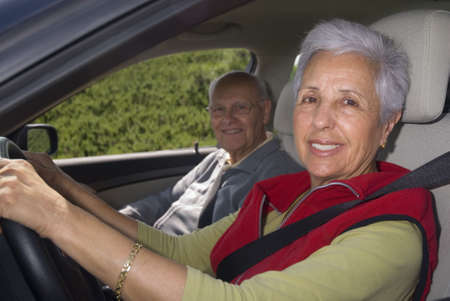 Happy senior couple out for a drive photo
