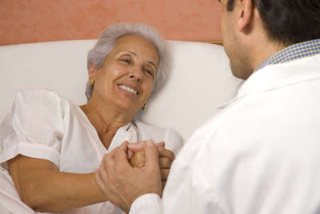 Male doctor with elderly woman patient Stock Photo - 3575020