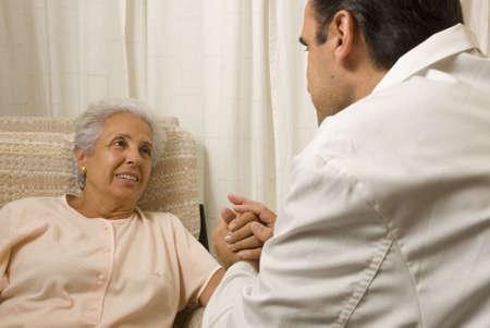 geriatrics: Male doctor with elderly woman patient Stock Photo