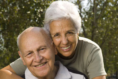 distinguished: Loving, handsome senior couple relaxing in the parc Stock Photo