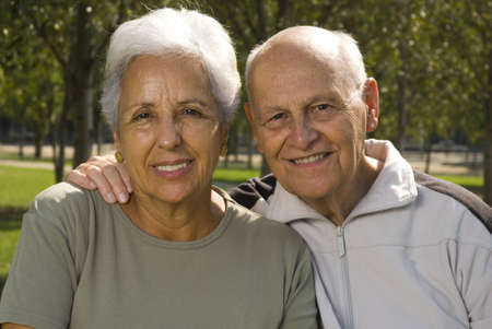 Loving, handsome senior couple relaxing in the parc Stock Photo - 3604038
