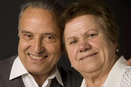 Lovely senior couple still in love on dark background Stock Photo - 4695733