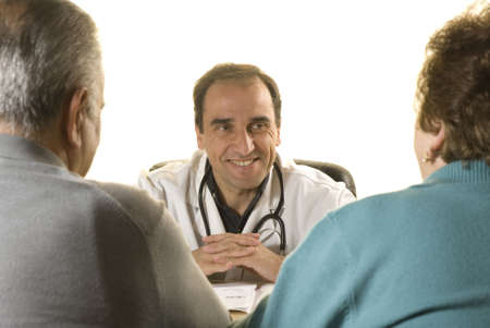 Senior couple at doctors consultation on white background photo