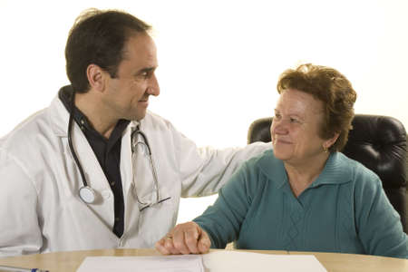 Senior patient at doctors consultation on white background photo