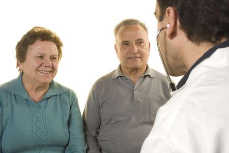 Senior couple at doctors consultation on white background