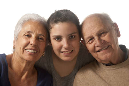 75s: Grandparents with granddaughter in a studio shoot