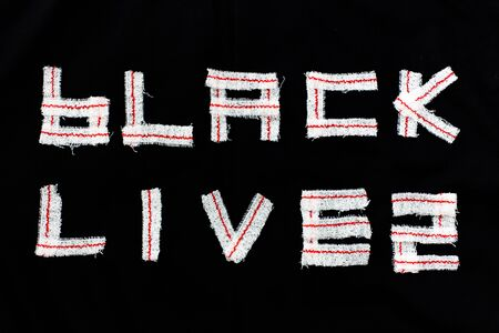 BLACK BACKGROUND WITH LETTERS BLACK LIVES MADE WITH elastic bandages