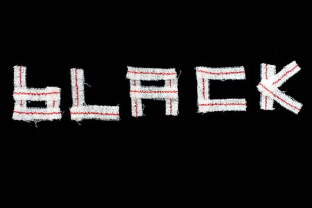 BLACK BACKGROUND WITH LETTERS BLACK MADE WITH elastic bandages