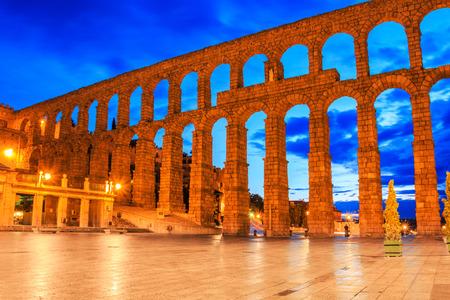 colonnade: Segovia, Spain. View at Plaza del Azoguejo and the ancient Roman aqueduct.