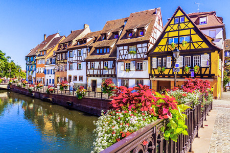 Colmar, Alsace, France. Petit Venice, water canal and traditional half timbered houses.