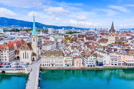 Zurich, Switzerland. View of historic Zurich city center with famous Fraumunster Church, Limmat river and Zurich lake from Grossmunster Church.
