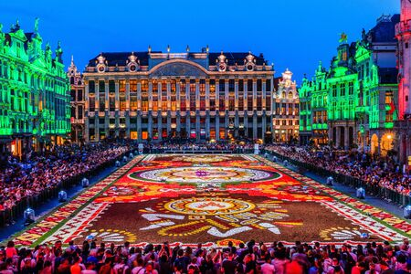 Brussels, Belgium  - August 16, 2018: Grand Place at night during Flower Carpet Festival.